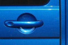 Metallic blue car door handle Stock Photos