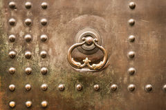 Metallic, bolts, ancient, door. Detail of an old metal door studded Stock Photo