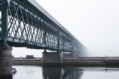 A metallic bridge in a foggy day Stock Image