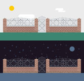 Metallic and brocks fence  on night Stock Photos