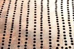 Metallic bronze textured background. With pattern of round cells in line royalty free stock image