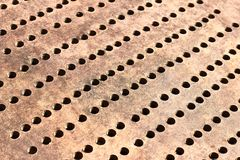 Metallic bronze textured background. With pattern of round cells in line stock photos