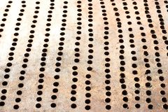 Metallic bronze textured background with pattern of round cells in line. Texture, backlit stock photos