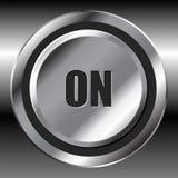 Metallic on button. Metallic on interface round button over metallic surface Royalty Free Stock Image