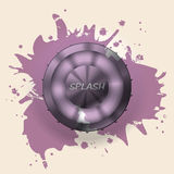 Metallic button splattered with paint Royalty Free Stock Images