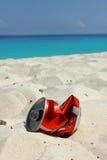 Metallic can trash on the beach Stock Image