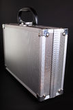 Metallic case. Case metallic on a dark background Royalty Free Stock Image