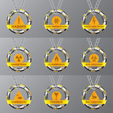 Metallic caution signs hanging on chains. Metallic caution signs with symbols hanging on chains Royalty Free Stock Photos