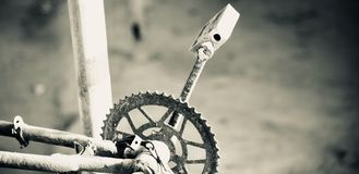Metallic chain cranks of a bicycle. Metallic chain cranks with paddles of a bicycle unique photo stock image