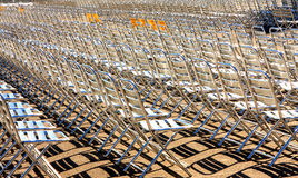 Metallic chairs. Multitude of metallic chair aligned in the sun for a concert Vienna Austria Royalty Free Stock Photo