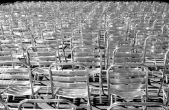 Metallic chairs. Multitude of metallic chair aligned in the sun for a concert Vienna Austria Stock Photos