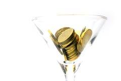 Metallic chinks and wineglass Royalty Free Stock Image