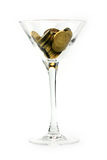 Metallic chinks and wineglass Stock Images