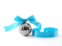 Close up single metallic glossy christmas ball with bright blue ribbon bow isolated on white background. Metallic glossy christmas ball with bright blue ribbon stock photos