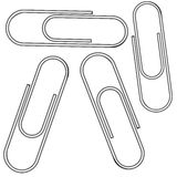 Metallic clips against white Royalty Free Stock Images