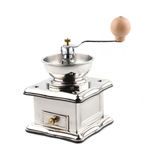 Metallic coffee mill. Isolated on a white background Stock Photography
