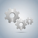 Metallic cogwheels with brushed surface and without spokes Royalty Free Stock Image
