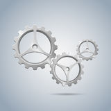 Metallic cogwheels with brushed surface and three spokes Stock Photography
