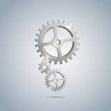 Metallic cogwheels with brushed surface in vertically placed Royalty Free Stock Photography