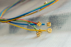 Metallic, colorful strings for an acoustic guitar Royalty Free Stock Photography