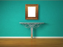 Metallic console-table with antique frame Stock Photography