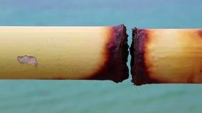 Metallic corrosion. Yellow pipe with metallic corrosion stock video footage