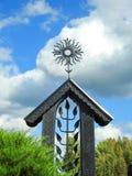 Metallic cross in cemetery. Beautiful artistic metallic blac cross in catholic cementery, Lithuania Royalty Free Stock Image