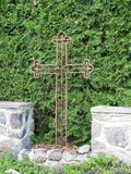 Metallic cross in cemetery. Old metallic cross in Sveksna town cementary , Lithuania Stock Images