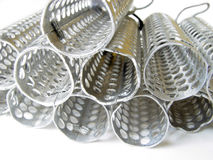 Metallic curlers close-up. Object over white Stock Images
