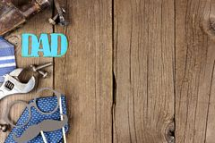 Metallic DAD sign with side border on wood. Metallic DAD sign with side border of tools and ties on a wooden background Royalty Free Stock Photos