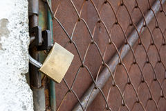 Metallic Door Closed and Locked with a Padlock Stock Photography
