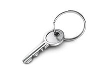 Metallic door key with ring on white background Stock Image