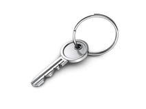 Metallic door key with ring on white background Stock Image