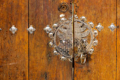 Metallic door knob on wooden door Stock Photo