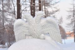 Metallic double-headed eagle. Russian imperial symbol. Fragments of old fence in park on Elagin island, St.Petersburg, Russia royalty free stock image