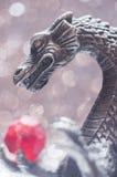 Metallic dragon holding a bead Royalty Free Stock Photos