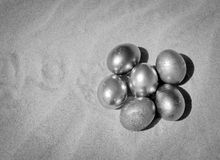 Metallic Easter Eggs in the sand Royalty Free Stock Photography