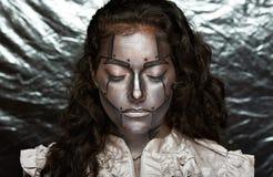 Metallic face of women Stock Image