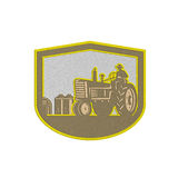 Metallic Farmer Driving Tractor Plowing Farm Shield Retro Royalty Free Stock Images