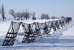 Metallic fence against snow storm Royalty Free Stock Photos