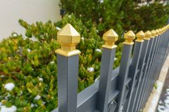 A metallic fence. With a golden tip Royalty Free Stock Photos