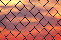 Metallic fence at sunset Royalty Free Stock Images