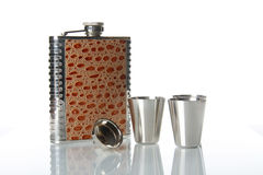 Metallic flask for alcohol on mirror table Royalty Free Stock Photography