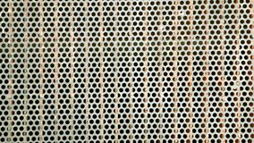 Metallic floor grate. A piece of a metallic grate used to cover a big tunnel or a electric sub terrain installation, street floor texture background Stock Photo