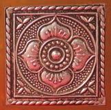 Metallic floral pattern. Embossed metallic handmade floral pattern Stock Photos