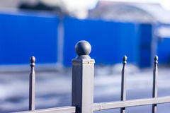 Metallic forged fence with balls and spikes. Royalty Free Stock Image