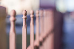 Metallic forged fence with balls and spikes. Royalty Free Stock Photo