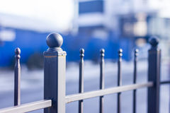 Metallic forged fence with balls and spikes. Stock Photo