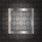 Metallic frame over wall Stock Image