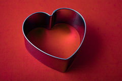 Metallic frame in the shape of heart Stock Photography